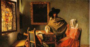 vermeer-gentiluomo-e-donna-che-beve